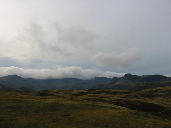 Pike O' Blisco, Crinkle Crags and Bowfell in cloud, the Langdale Pikes