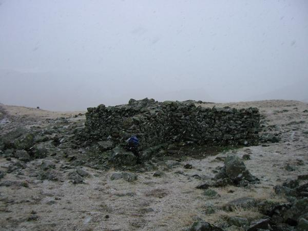 Shelter at lower Esk Hause and its now snowing