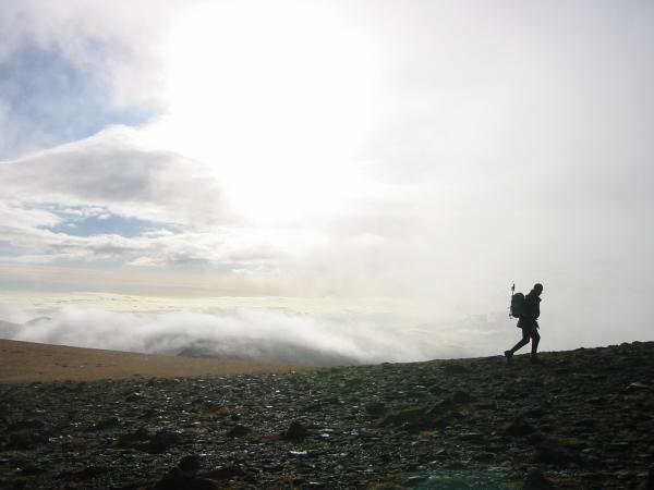 A walker approaches the summit