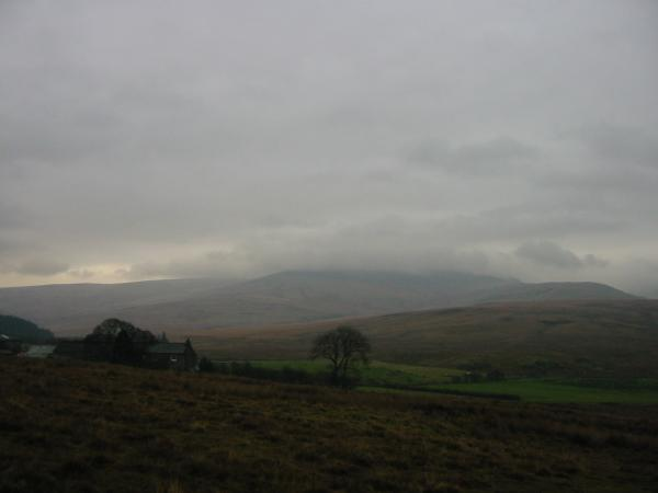 Scalderskew with high fells lost in cloud