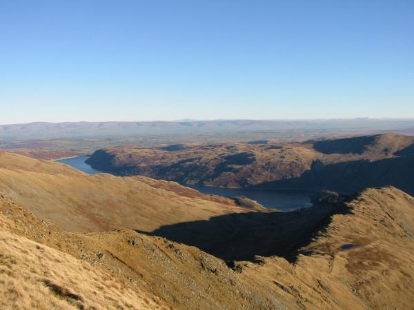 Long Stile leading down to Rough Crag, Haweswater and The Pennines in the distance