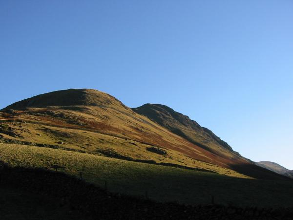 Gray Crag's west face catching the sun from the track back to Hartsop