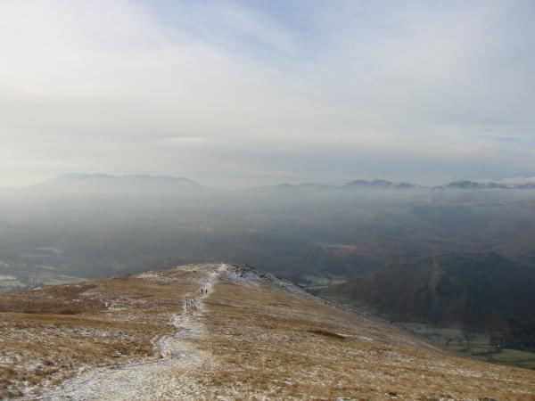 Looking back down the ridge to Stone Arthur with the Coniston and Langdale Fells in the distance