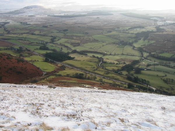 Looking back down on the A66 with Great Mell Fell top left