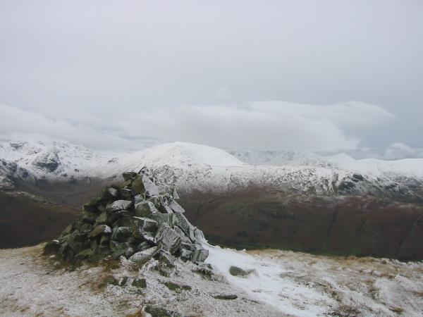 A snow covered Saint Sunday Crag from Brock Crags' summit cairn