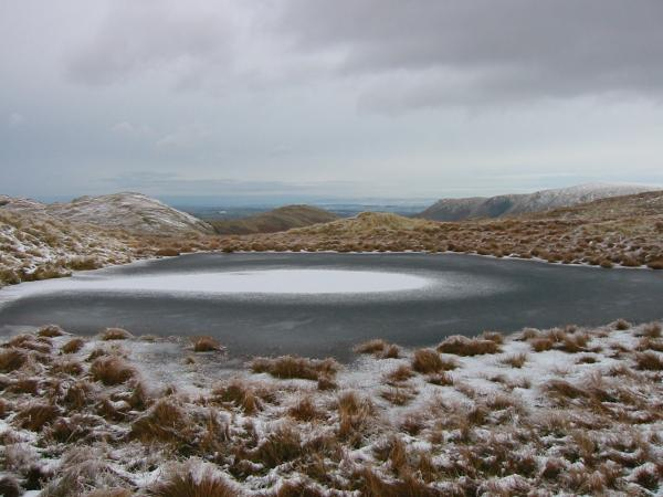 Frozen tarn on Brock Crags