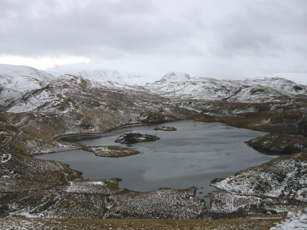 Looking back down on Angle Tarn from the ascent of Angletarn Pikes' southern top
