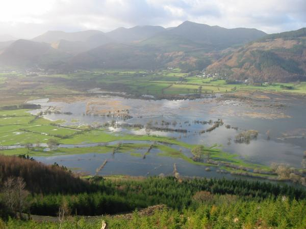 Flooded fields at the head of Bassenthwaite Lake with the north western fells beyond