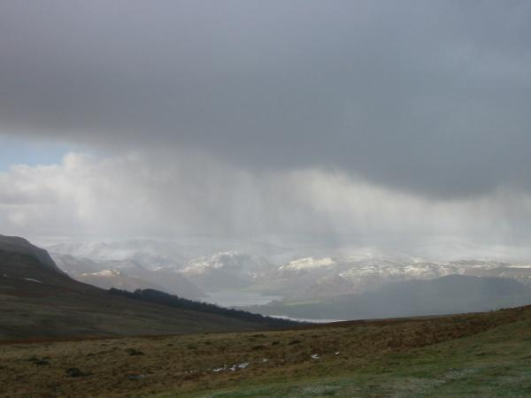 Ullswater and the Helvellyn range from Heughscar Hill as the weather briefly closes in