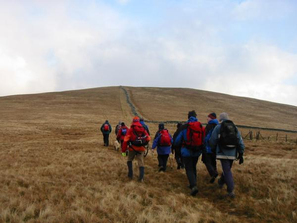 Out of the cloud and heading from Lonscale Fell