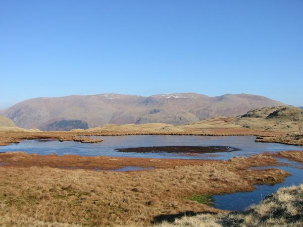 The Helvellyn ridge from one of the tarns on the ridge to Calf Crag