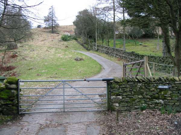 An electrically operated gate and the drive of 'Hillside', the start of the climb