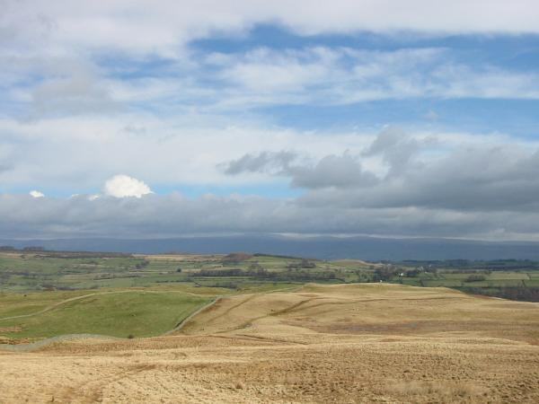 Looking east to the Pennines from the route up Harper Hills