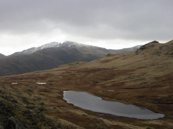 Red Tarn and a touch of snow on Swirl How and Great Carrs to the south
