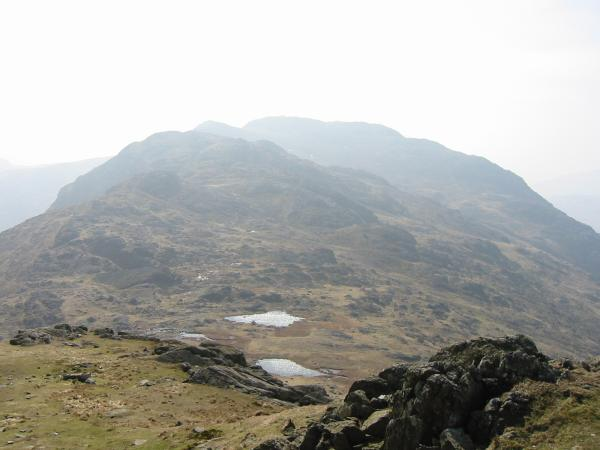 Looking back across Three Tarns to Crinkle Crags from the route up Bowfell