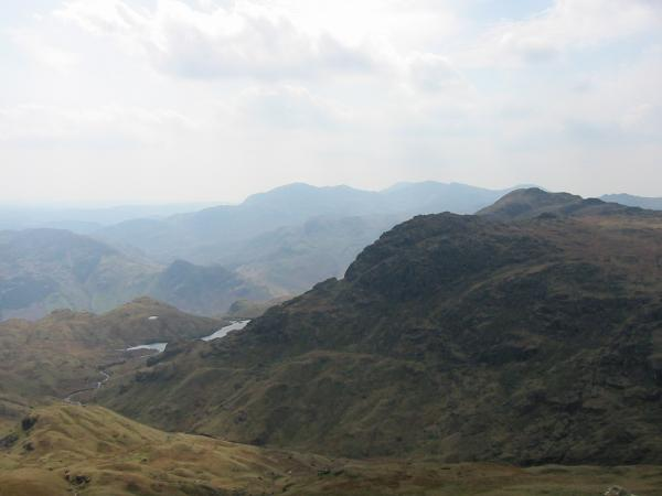 Stickle Tarn and Pavey Ark from Sergeant Man's summit with the Coniston Fells beyond