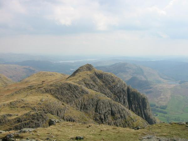 Loft Crag with Gimmer Crag a famous climbing crag on its south face, from Pike O' Stickle's summit