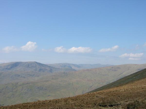 Fairfield and Helvellyn seen through the gap between Red Screes and Caudale Moor