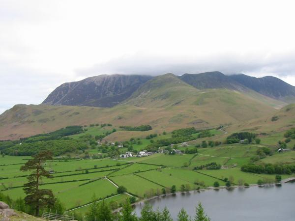 Buttermere village below the Grasmoor Fells from above Burtness Wood