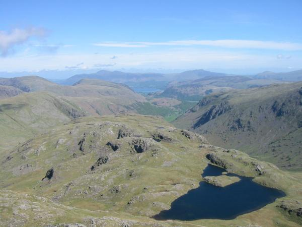 Looking over Sprinkling Tarn and Seathwaite Fell to Skiddaw and Blencathra
