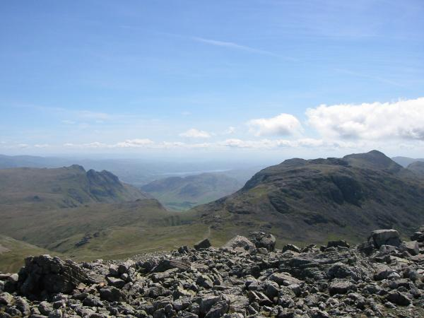 The Langdale Pikes, Esk Pike and Bowfell with Windermere in the distance from Great End's southeastern summit cairn