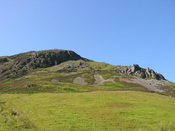 Looking up to Revelin Crag and the pinnacles from the col