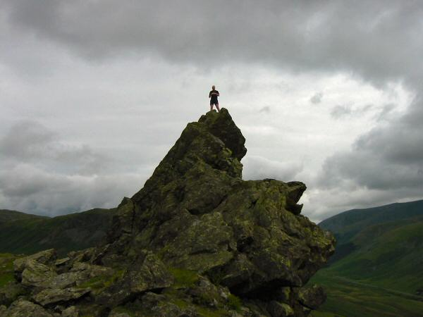 Andy Wallace on top of the Howitzer, Helm Crag summit