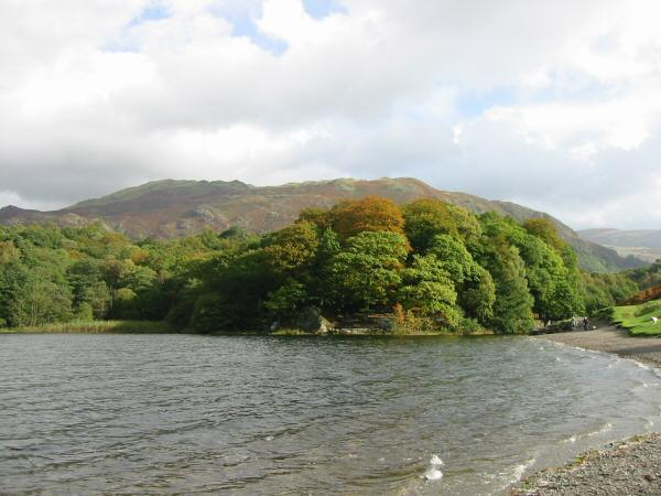 Looking back along Grasmere's shoreline to Penny Rock with Heron Pike and Nab Scar behind