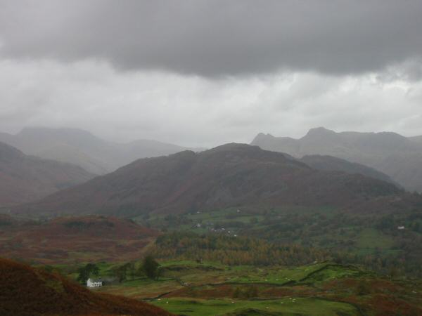 Bowfell (in cloud), the Langdale Pikes, Lingmoor Fell and the white farm house of Low Arnside