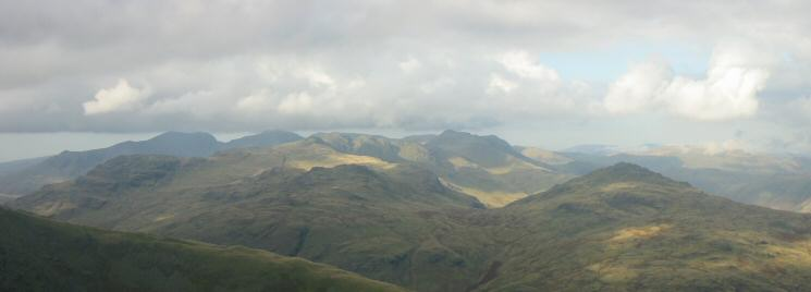 Looking over Wet Side Edge to the Scafells, Crinkle Crags, Bowfell and Pike O' Blisco from near Wetherlam's summit