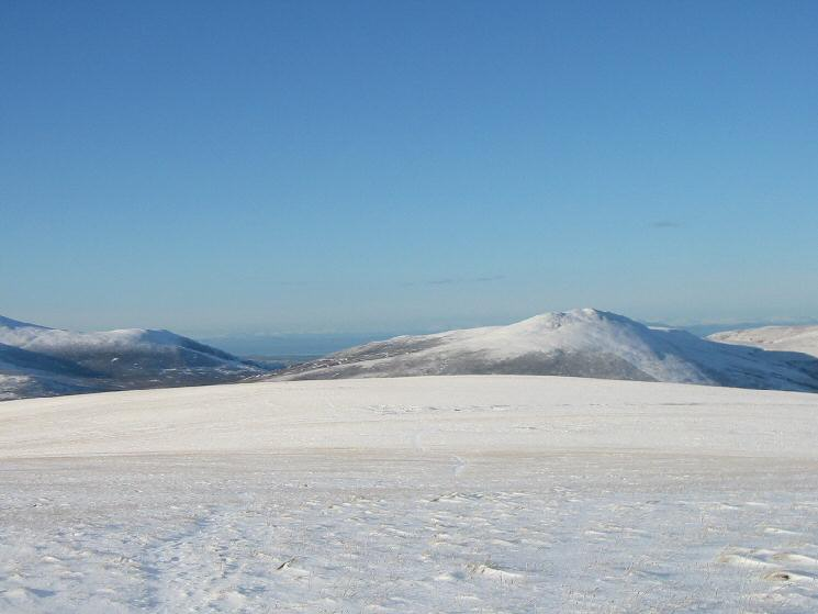Looking north across the flat top of Mungrisdale Common towards Bakestall and Great Calva