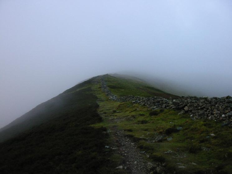 Grisedale Pike's north eastern ridge disappears into the cloud