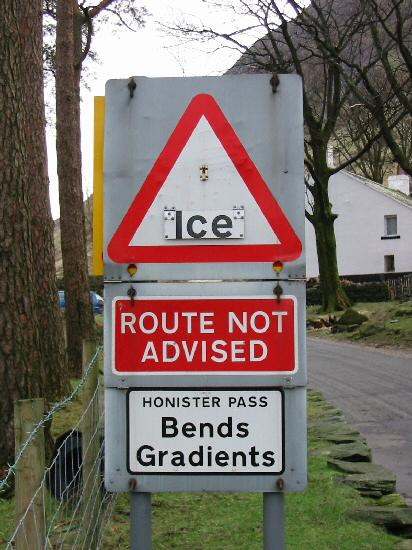 Road sign at the bottom of Honister Pass at Gatesgarth