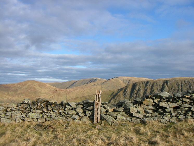 The wooden post that marks the summit of Hartsop Dodd