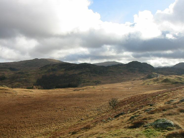 The view south back to Great Crag with Ullscarf on the left and High Raise in the distance