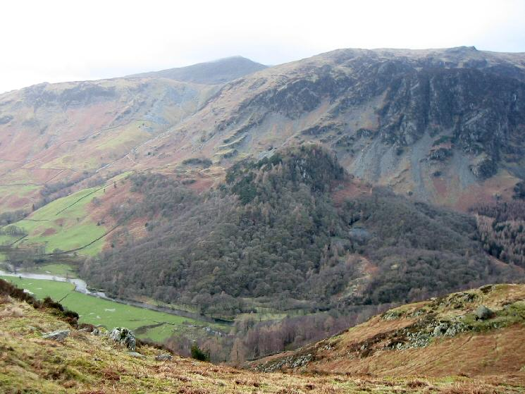 A wooded Castle Crag from Grange Fell