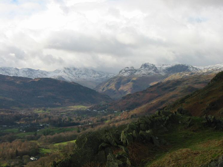 Zooming in on Bowfell, with its top in cloud and the Langdale Pikes