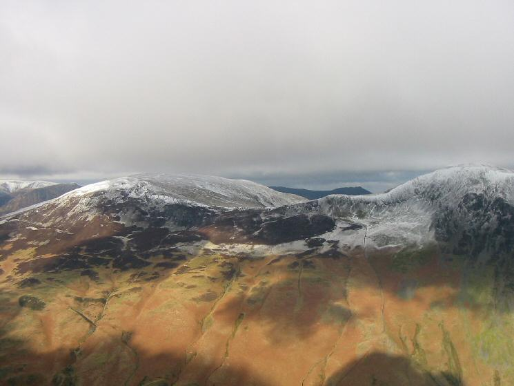 Snow on Robinson and Hindscarth with a dark Causey Pike in the  distance