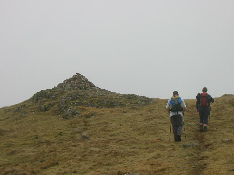 Approaching Crag Fell's summit cairn