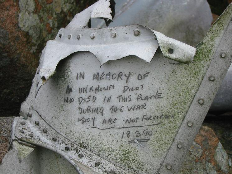 Aircraft wreckage next to the summit cairn on Iron Crag