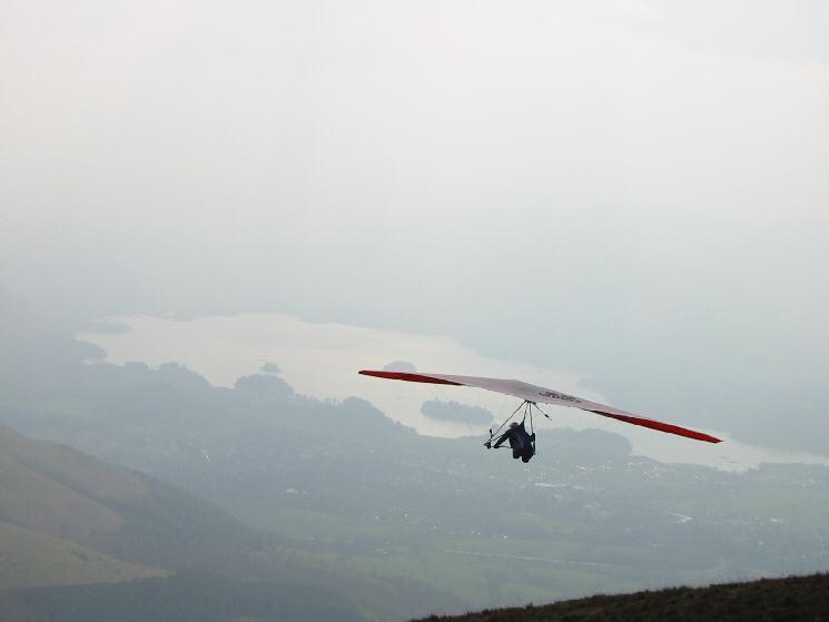 Handglider taking off with Derwent Water below