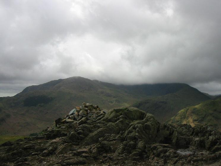 The Coniston Fells in cloud from Lingmoor Fell's summit