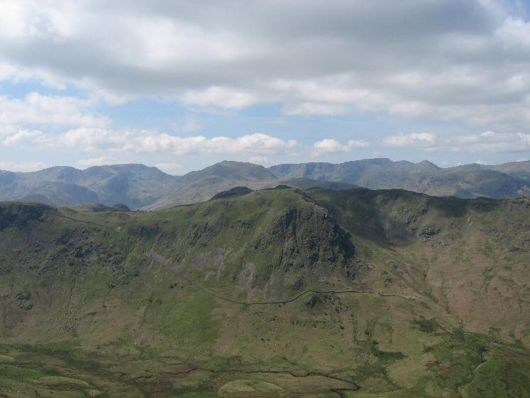 Heck Crag with Fairfield, Saint Sunday Crag, Helvellyn and the pointed Catstycam on the skyline from The Nab's summit