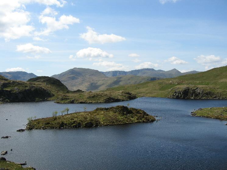 Looking across Angle Tarn to Fairfield, Saint Sunday Crag, Helvellyn and Catstycam