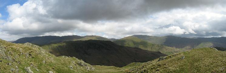 Steel Fell in shadow with the Helvellyn ridge, Seat Sandal and the Fairfield fells behind