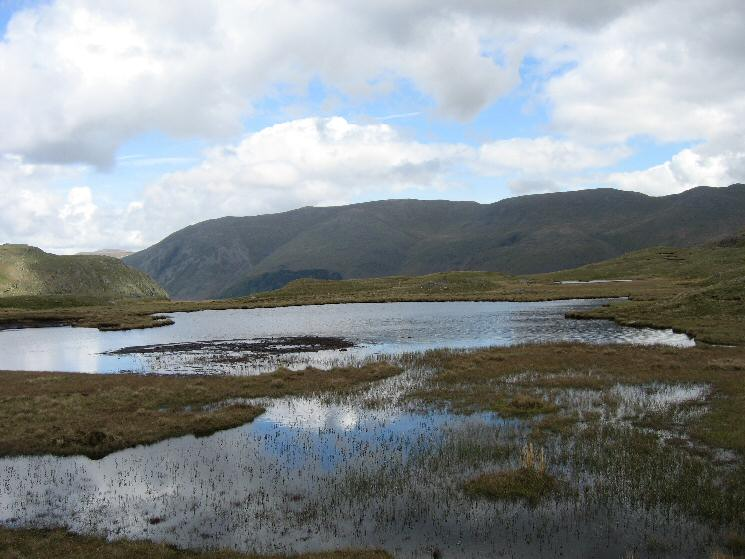 Helvellyn from the large nameless tarn on the wide ridge to Steel Fell