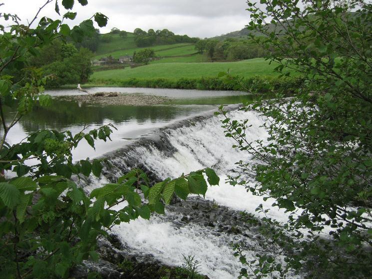 The weir across the River Kent near Barley Bridge