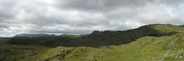 The Blea Rigg ridge (in shadow) and Codale Head on the far right with the Coniston Fells and Harrison Stickle behind from Tarn Crag