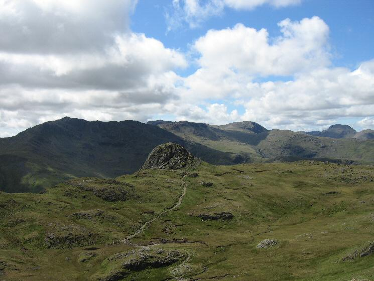 Pike O' Stickle with Bowfell, Scafell Pike, Great End and Great Gable behind from Harrison Stickle