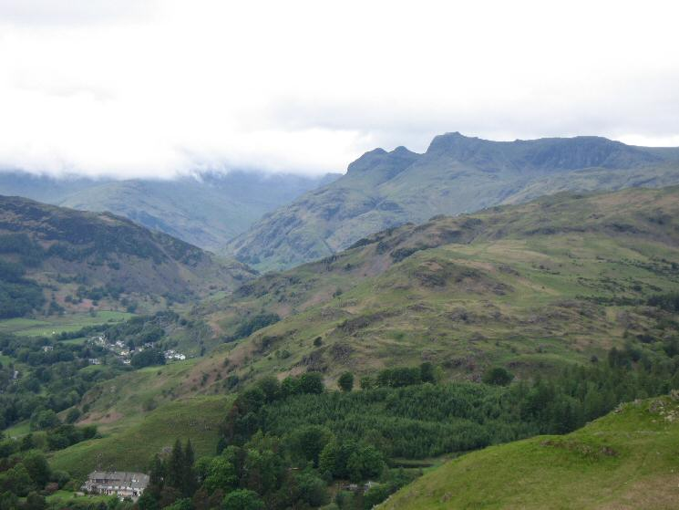The Langdale Pikes from Loughrigg Fell's summit with High Close YHA bottom left